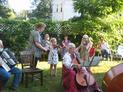 Charlie on accordion; Cindi with daughters Jana and Lenore; Sabina on cello