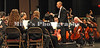 Charles Jones Evans, Music Director/Conductor leads the Symphony Orchestra during Saturday evening's performance.
