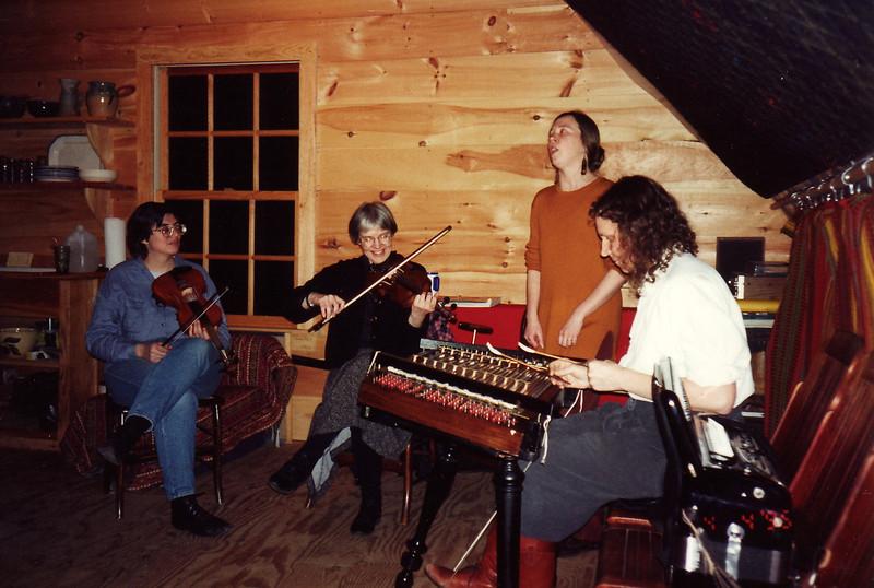 Balkan music jam in Becky's attic, April 1995.  Lila, Jenny, Kate, and Becky.