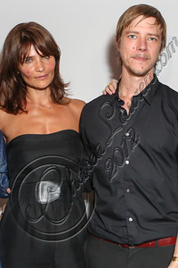 "LOS ANGELES, CA - SEPTEMBER 01:  Model Helena Christensen (L) and musician Paul Banks attend the listening party for Paul Banks' album ""Julian Plenti Lives..."" at Sonos Studio on September 1, 2012 in Los Angeles, California.  (Photo by Chelsea Lauren/WireImage)"