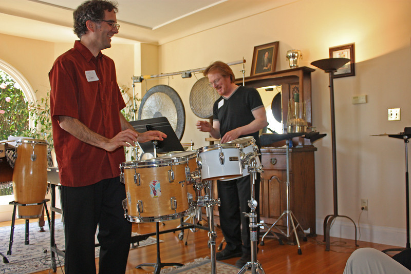 Duet on the drums, without sticks