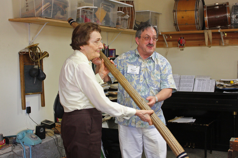 Harry Howe and Genevieve Power, with the rain stick