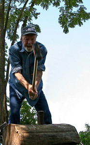 Pete Seeger.  Yes, he really does split his own fire wood.  Here here is swinging the maul while singing about working on the railroad. We've seen him do this many times and he never misses.  Not bad for an 88 year old guy.