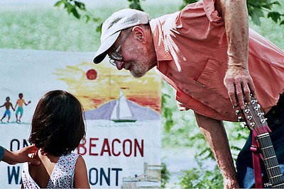 Pete Seeger talking about the Hudson with a young fan near his Beacon, NY home.  This image was used in the jacket of Pete's newest Grammy Award winning CD, Tomorrow's Children, released in 2010 by Appleseed Records.