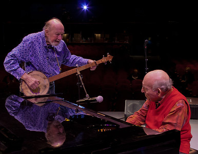 Pete Seeger and George Wein at sound check on the Symphony Space stage, NYC.