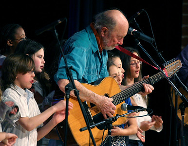Pete Seeger doing one his favorite things, performing with kids.   Here he's at the local high school near his home in Beacon, NY playing before a full house with these grade schoolers, The Rivertown Kids.  Check out our shot of Pete with these kids in the liner of his Grammy winning CD At 89.