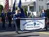 Banner--  QCSHS Marching Band in Parade