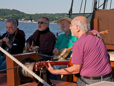 David Amram, Raffi, Pete Seeger and Peter Yarrow onboard the Hudson River Sloop Clearwater, 2013.