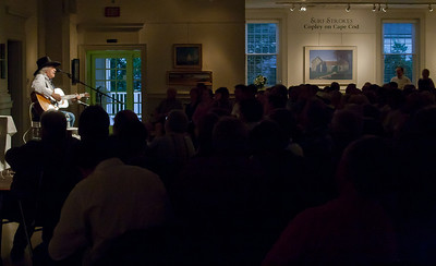 Ramblin Jack Elliott palying to a full house on his 80th birthday at the Cape Cod Cultural Center, Yarmouth, MA.