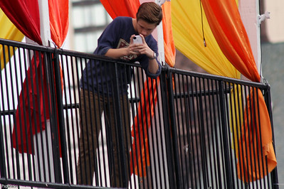 """Here's Ryan Beatty photographing his fans waiting for him in the rain. Ryan is on the balcony of the concert venue, a music club called """"Up or On The Rocks"""" in Hartford, Connecticut on September 30, 2012. Ryan tweeted the photo he took (http://twitter.com/TheRyanBeatty/status/252494835280400385 ), thinking nobody noticed him. Gotcha Ryan."""