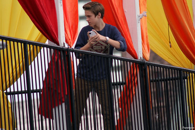"""Here's Ryan Beatty after photographing his fans waiting for him in the rain. Ryan is on the balcony of the concert venue, a music club called """"Up or On The Rocks"""" in Hartford, Connecticut on September 30, 2012. Ryan tweeted the photo he took (http://twitter.com/TheRyanBeatty/status/252494835280400385 ), thinking nobody noticed him. Gotcha Ryan."""
