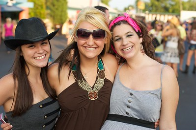 Paige Rotham, Amber Gumdrum and Julie McGoffin of Cincinnati at Riverbend on Friday for Rascal Flatts