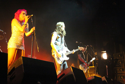 Ruby, Joe and Richie, with Richie's son Jack taking photos from the side of the stage.