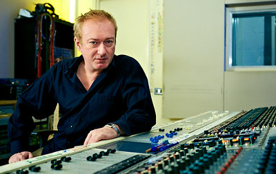 Record Producer and musician Andy Gill sits behind his Neve mixing console at his private recording studio London, UK   -  Watch our exclusive Andy Gill video interviews here:  http://www.recordproduction.com/andy_gill.htm