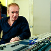 """Record Producer and musician Andy Gill sits behind his Neve mixing console at his private recording studio London, UK   -  Watch our exclusive Andy Gill video interviews here:  <a href=""""http://www.recordproduction.com/andy_gill.htm"""">http://www.recordproduction.com/andy_gill.htm</a>"""