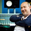 Rollo Armstrong of Faithless behind his SSL AWS 900+ at his home recording studio in the UK