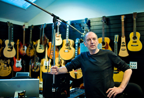 Stephen Lipson poses by his guitar collection at SARM Studios London UK PUBLISHED:  Resolution Magazine, UK   -   Watch our video interview with Steve Lipson:  http://www.recordproduction.com/steve-lipson-record-producer.html