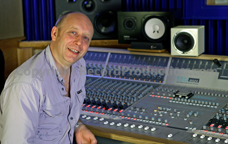"""Recording engineer Mark behind the mixing console at Deep recording studios, London,UK.  Watch our features on  <a href=""""http://www.RecordProduction.com"""">http://www.RecordProduction.com</a>"""