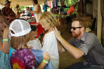 Jake signing t-shirts for some young fans.