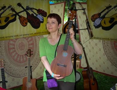 Lila with her new baritone ukulele.