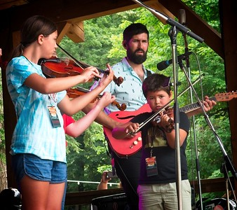 Jay Lapp of the Steel Wheels plays with his daughter and son.