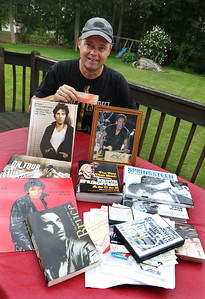 Barry Scanlon of Chelmsford with books and other memorabilia of The Boss, Bruce Springsteen, including a ticket from the first Springsteen concert he went to, in Saratoga Springs onJuly 27, 1984.  The ticket was $10 plus $1 tax. SUN/Julia Malakie