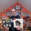 """Johnny Girouard is a Beatles fan with a ton of memoribilia and on thursday night he talk and about the Beatles and the 50th anniversary of their first American TV appearance in his house surrounded by all the  music posters, records, instruments and other stuff he has collected over the years. Here he shows off just two of the Beatles 45's he has in his collection. """"Do you wnat to know a secert"""" and """"Real Love."""" SENTINEL & ENTERPRISE/JOHN LOVE"""