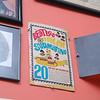 """Johnny Girouard is a Beatles fan with a ton of memoribilia and on thursday night he talk and about the Beatles and the 50th anniversary of their first American TV appearance in his house surrounded by all the  music posters, records, instruments and other stuff he has collected over the years. Here is a special edition of the Beatles """"Yellow Submarine"""" song that he has hanging on his wall.  SENTINEL & ENTERPRISE/JOHN LOVE"""