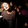 "Kelly Seitz, of Denver, front, dances to the music on Friday, Dec. 9, during a benefit concert at the Rhinoceropolis warehouse on Brighton Boulevard in Denver. For more photos and video of the concert go to  <a href=""http://www.dailycamera.com"">http://www.dailycamera.com</a><br /> Jeremy Papasso/ Camera"