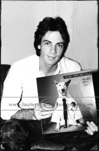 "RickSpringfield_091181_102 Musician and actor (""General Hospital"" ""Californication"") Rick Springfield is pictured sitting on a sofa holding is 1981 RCA Album release ""Working Class Dog"" which featured his break out single ""Jessie's Girl"""