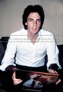 "RickSpringfield_091181_103 Pop music star and actor Rick Springfield of Jessie's Girl and General Hospital  and Californication fame photographed live in concert during the height of his popularity in the 1980s. Rick Springfield is pictured holding his 1981 RCA Album ""Working Class Dog"" which featured Rick Springfield's break out hit, ""Jessie's Girl"""