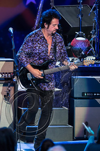 LOS ANGELES, CA - JULY 21:  Musician Steve Lukather performs with Ringo Starr and his All Starr band at The Greek Theatre on July 21, 2012 in Los Angeles, California.  (Photo by Chelsea Lauren/WireImage)