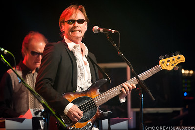 Richard Page smiles for the camera as he performs with Ringo Starr & His All-Starr Band at Ruth Eckerd Hall in Clearwater, Florida on July 13, 2010. The band also features Wally Palmar, Rick Derringer, Edgar Winter, Gary Wright, and Gregg Bissonette.