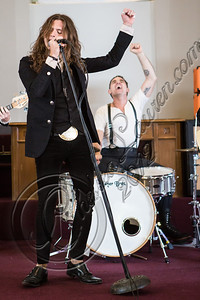 "LOS ANGELES, CA - JULY 30:  ((EXCLUSIVE COVERAGE)) Vocalist Jay Buchanan (L) and drummer Mike Miley of Rival Sons perform at the ""Keep On Swinging"" music video shoot on July 30, 2012 in Los Angeles, California.  (Photo by Chelsea Lauren/WireImage)"