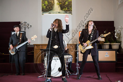 "LOS ANGELES, CA - JULY 30:  ((EXCLUSIVE COVERAGE)) (L-R) Vocalist Jay Buchanan, drummer Mike Miley and guitarist Scott Holiday of Rival Sons perform at the ""Keep On Swinging"" music video shoot on July 30, 2012 in Los Angeles, California.  (Photo by Chelsea Lauren/WireImage)"