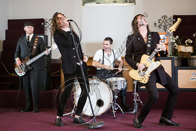 "LOS ANGELES, CA - JULY 30:  ((EXCLUSIVE COVERAGE)) (L-R) Bassist Robin Everhart, vocalist Jay Buchanan, drummer Mike Miley and guitarist Scott Holiday of Rival Sons perform at the ""Keep On Swinging"" music video shoot on July 30, 2012 in Los Angeles, California.  (Photo by Chelsea Lauren/WireImage)"
