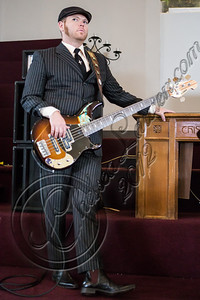 """LOS ANGELES, CA - JULY 30:  ((EXCLUSIVE COVERAGE)) Bassist Robin Everhart of Rival Sons performs at the """"Keep On Swinging"""" music video shoot on July 30, 2012 in Los Angeles, California.  (Photo by Chelsea Lauren/WireImage)"""
