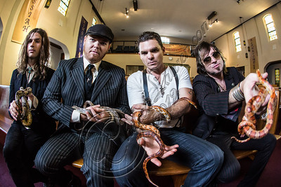 "LOS ANGELES, CA - JULY 30:  ((EXCLUSIVE COVERAGE)) (L-R) Vocalist Jay Buchanan, bassist Robin Everhart, drummer Mike Miley and guitarist Scott Holiday of Rival Sons pose at the ""Keep On Swinging"" music video shoot on July 30, 2012 in Los Angeles, California.  (Photo by Chelsea Lauren/WireImage)"