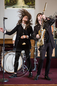 "LOS ANGELES, CA - JULY 30:  ((EXCLUSIVE COVERAGE)) Vocalist Jay Buchanan (L) and guitarist Scott Holiday of Rival Sons perform at the ""Keep On Swinging"" music video shoot on July 30, 2012 in Los Angeles, California.  (Photo by Chelsea Lauren/WireImage)"