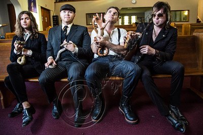 """LOS ANGELES, CA - JULY 30:  ((EXCLUSIVE COVERAGE)) (L-R) Vocalist Jay Buchanan, bassist Robin Everhart, drummer Mike Miley and guitarist Scott Holiday of Rival Sons pose at the """"Keep On Swinging"""" music video shoot on July 30, 2012 in Los Angeles, California.  (Photo by Chelsea Lauren/WireImage)"""