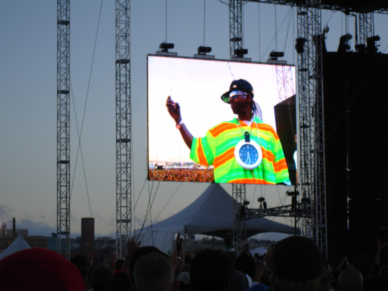 Flavor Flav taking photos on stage with an iPhone
