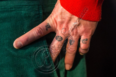 LOS ANGELES, CA - DECEMBER 11:  Bassist Flea of The Red Hot Chili Peppers (tattoo detail) attends the Rock & Roll Hall of Fame 2013 Inductee Press Conference at Nokia Theatre L.A. Live on December 11, 2012 in Los Angeles, California.  (Photo by Chelsea Lauren/WireImage)
