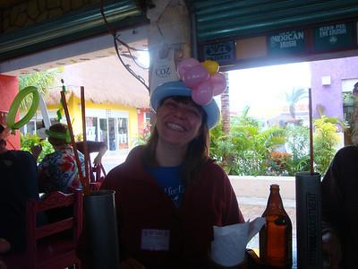 Sporting crazy balloon hats.