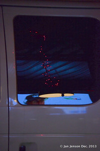 Christmas lights reflecting on van door