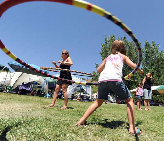 "Laura Hughes, left and Ella Cinalli, 7, hula hoop to blue grass music at RockyGrass on Saturday.<br /> For more photos and a video of RockyGrass, go to  <a href=""http://www.dailycamera.com"">http://www.dailycamera.com</a>.<br />  Cliff Grassmick / July 24, 2010"