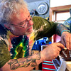 Gary Lundy works to put together a mandolin at the Rocky Grass Academy at Planet Bluegrass Ranch in Lyons on Thursday, July 22.<br /> Greg Lindstrom / The Camera