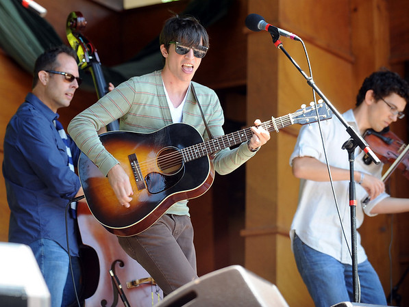 """Zach Bevill, center, sings with the Farewell Drifters on Saturday at RockyGrass in Lyons.<br /> For more photos and a video of RockyGrass, go to  <a href=""""http://www.dailycamera.com"""">http://www.dailycamera.com</a>.<br />  Cliff Grassmick / July 24, 2010"""