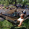 """Dan Williams, of Austin, TX, found a sweet spot  near North  St Vrain Creek and  the stage, to listen to RockyGrass music on Saturday in Lyons.<br /> For more photos and a video of RockyGrass, go to  <a href=""""http://www.dailycamera.com"""">http://www.dailycamera.com</a>.<br />  Cliff Grassmick / July 24, 2010"""