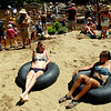 "Katie Nitke, left, and Kelsey McMillan, sit in tubes and listen to music at RockyGrass on Saturday.<br /> For more photos and a video of RockyGrass, go to  <a href=""http://www.dailycamera.com"">http://www.dailycamera.com</a>.<br />  Cliff Grassmick / July 24, 2010"
