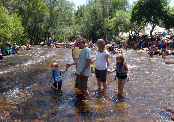 "Blue grass fans cool off in the North  St Vrain Creek while listening to RockyGrass on Saturday<br /> For more photos and a video of RockyGrass, go to  <a href=""http://www.dailycamera.com"">http://www.dailycamera.com</a>.<br />  Cliff Grassmick / July 24, 2010"